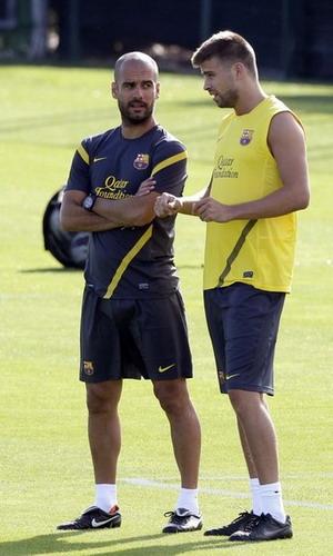 Pep Guardiola dan Pique (Foto: Daylife)