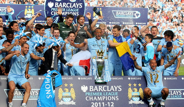 Manchester City merayakan trofi Premier League musim 2011-2012/Getty Images