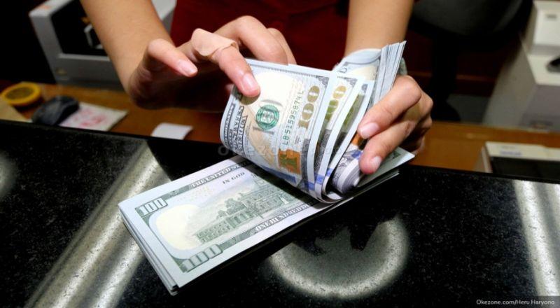 \Rupiah Pukul Balik Dolar ke Rp12.750\