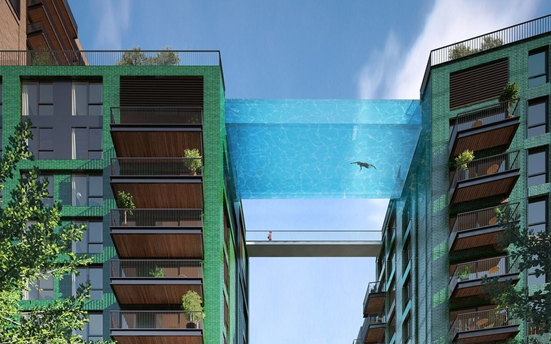 Awesome! Kolam Renang Kaca Pertama Di Dunia Yang Menghubungkan Dua Buah Apartment