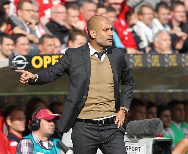 Guardiola dikabarkan resmi latih City. (Foto: AFP/Daniel Roland)