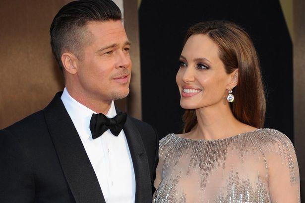 Kebersamaan Angelina Jolie dan Brad Pitt di sesi Red Carpet Ajang Oscar. (Foto: Mirror)