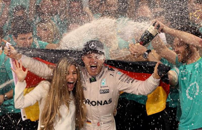 Nico Rosberg saat menjadi juara (Foto: Karim Sahib/AFP)