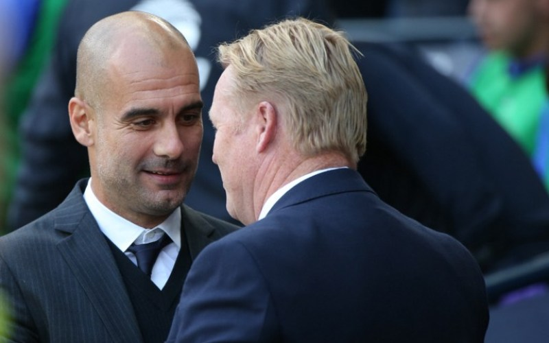 Pep Guardiola dan Ronald Koeman (Foto: AFP)
