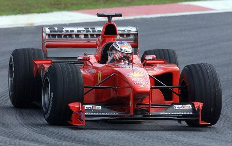 Ferrari di lintasan (Foto: AFP / Giuseppe Cacace)