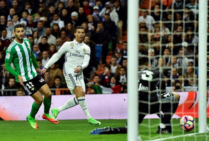 Ronaldo belum tentu juara Liga Spanyol. (Foto: AFP/Gerard Julien)