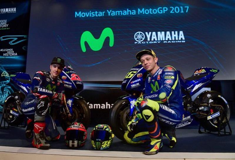Maverick Vinales dan Valentino Rossi (Foto: Pierre-Philippe Marcou/AFP)