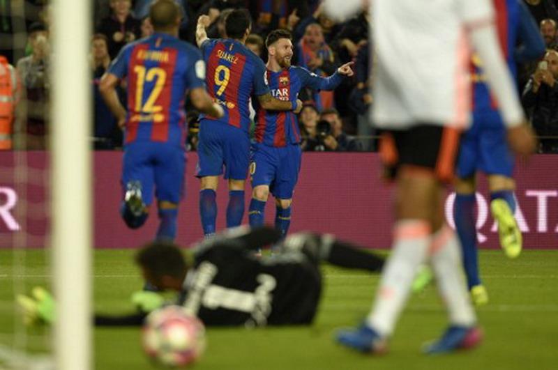 Barcelona sukses tundukkan Valencia 4-2. (Foto: AFP/Lluis Gene)