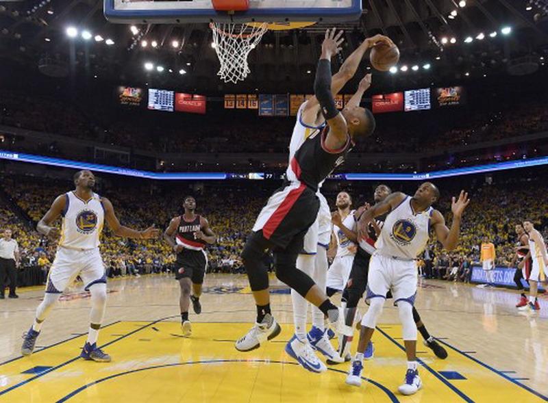 Golden State Warriors di pertemuan perdana babak pertama play-offs NBA kontra Portland (Foto: AFP)