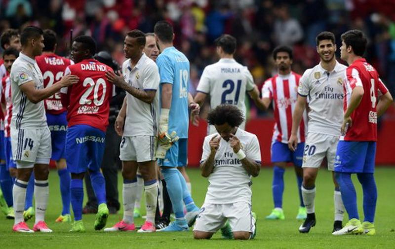 Madrid berhasil kalahkan Gijon 3-2. (Foto: AFP/Miguel Riopa)
