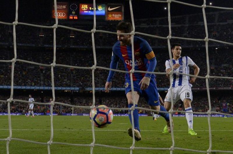 Messi top skor sementara Liga Spanyol. (Foto: AFP/Lluis Gene)