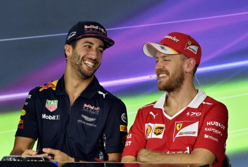 Sebastian Vettel dan Daniel Ricciardo (Foto: AFP)