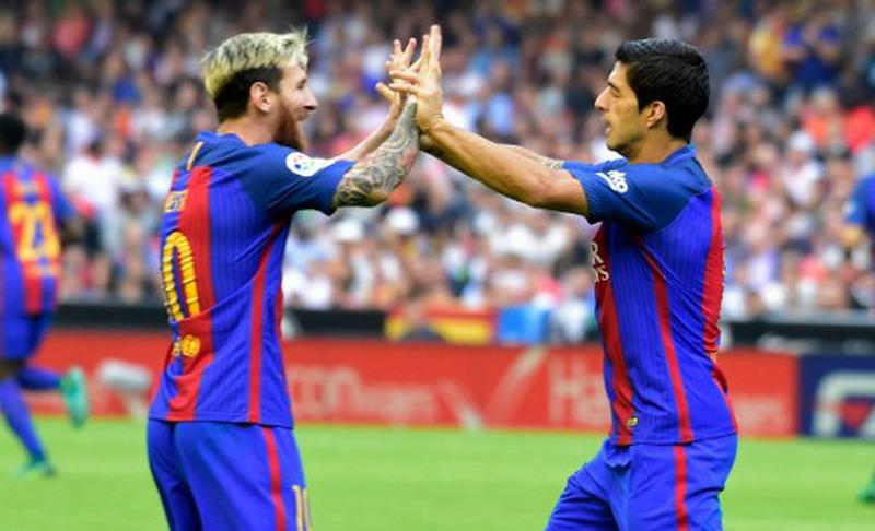 Messi dan Suarez, berada di posisi 1-2 top skor Liga Spanyol. (Foto: AFP/Jose Jordan)