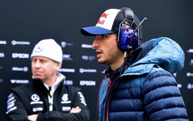Carlos Sainz, pembalap Toro Rosso (kanan) (Foto: Jose Jordan / AFP)