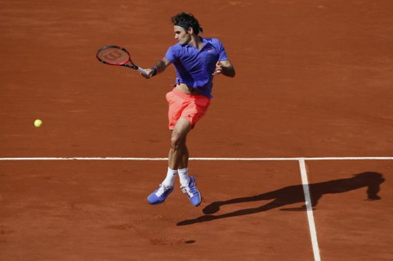 Roger Federer dipastikan tak tampil di Prancis Open 2017 (Foto: Patrick Kovarik/AFP)
