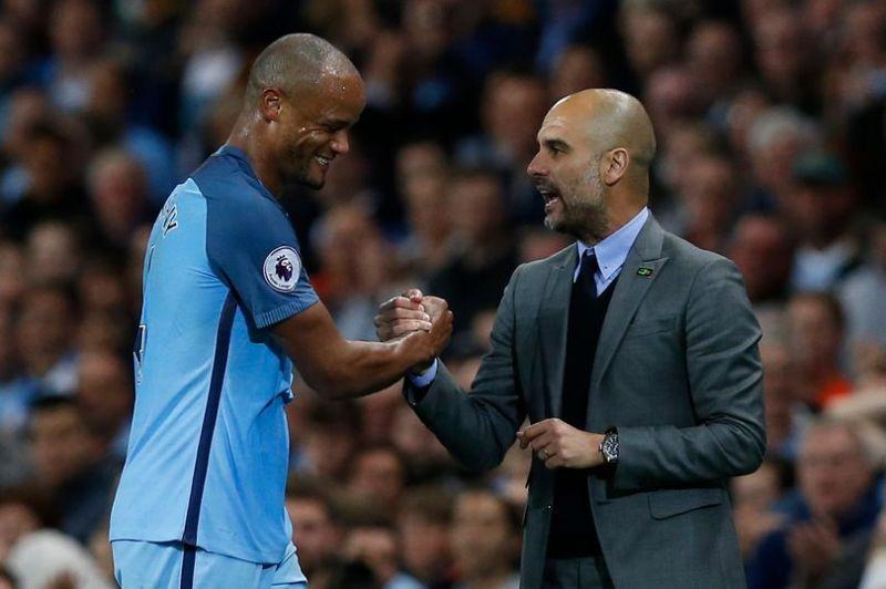 Vincent Kompany dan Josep Guardiola di Manchester City (Foto: Reuters)