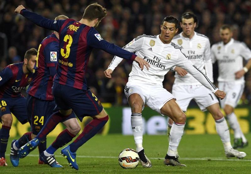 Madrid dan Barcelona paling sering tampil di Liga Champions. (Foto: AFP/LLuis Gene)