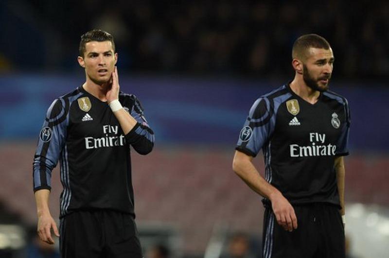 Cristiano Ronaldo dan Karim Benzema (Foto: Filippo Monteforte/AFP)