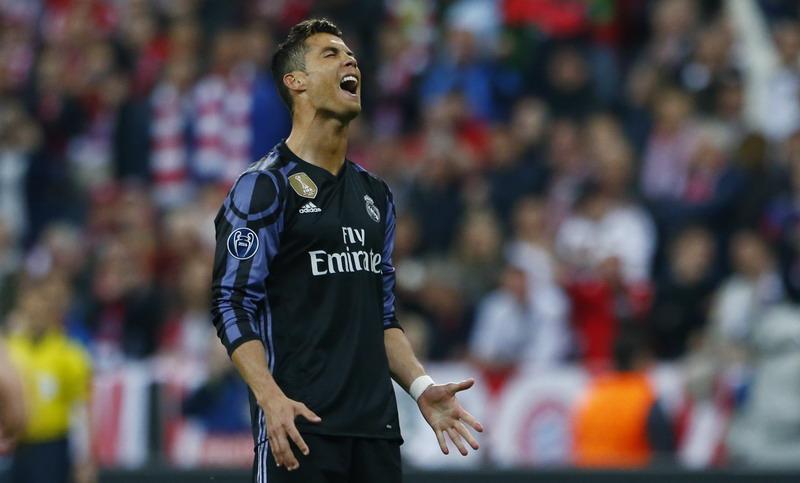 Ronaldo belum tentu tinggalkan Madrid. (Foto: REUTERS/Michael Rehle)