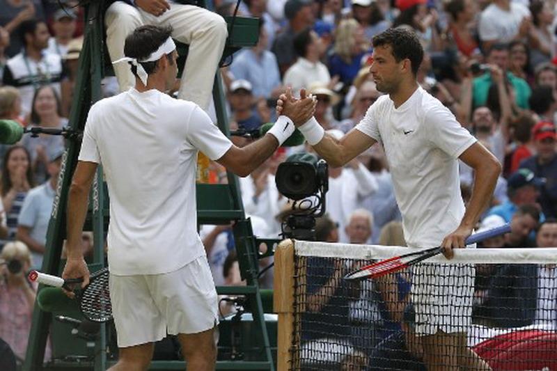 Roger Federer dan Grigor Dimitrov (Foto: AFP)