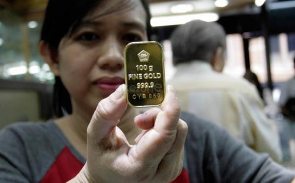\Tren Kenaikan Berhenti, Harga Emas Antam Tertahan di Rp592 Ribu   \