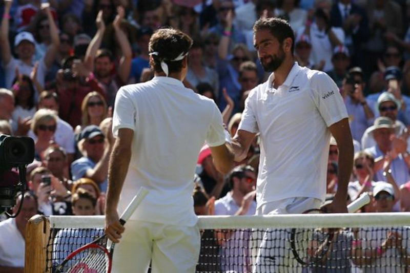 Federer vs Cilic (Foto: Justin Tallis/AFP)