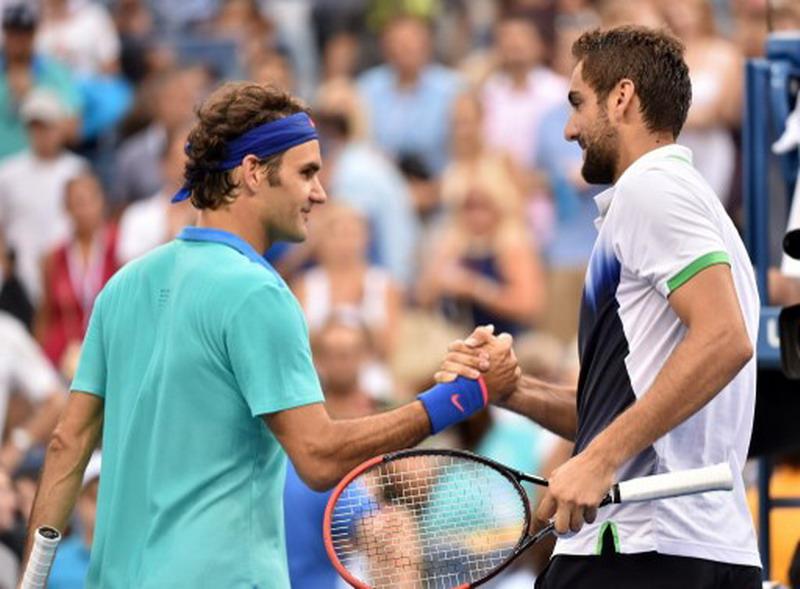 Roger Federer dan Marin Cilic (Foto: Stan Honda/AFP)