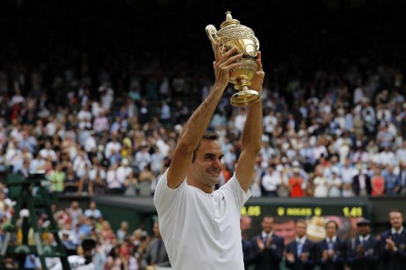 Roger Federer jadi juara Wimbledon 2017 (Foto: AFP)