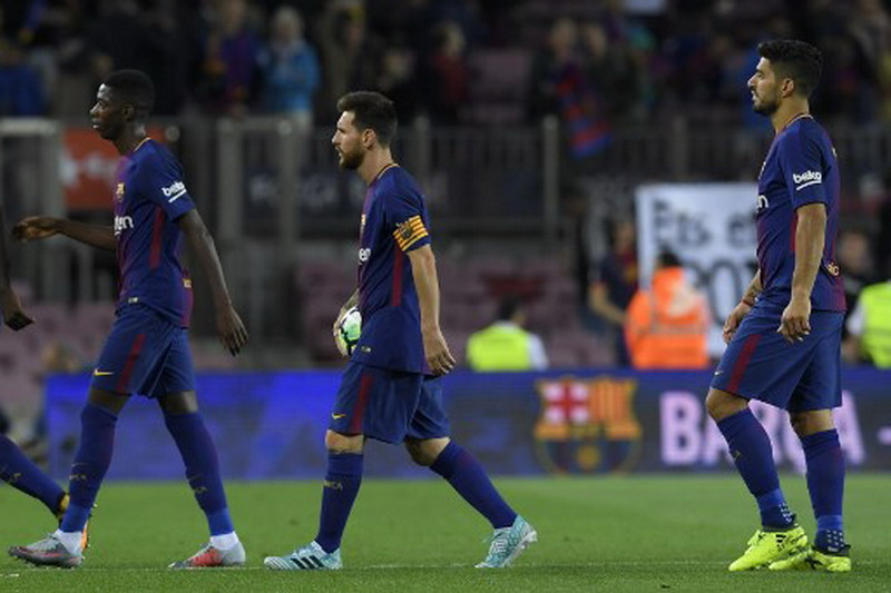 Dembele menemani Suarez dan Messi di lini depan Barcelona. (Foto: AFP/Lluis Gene)