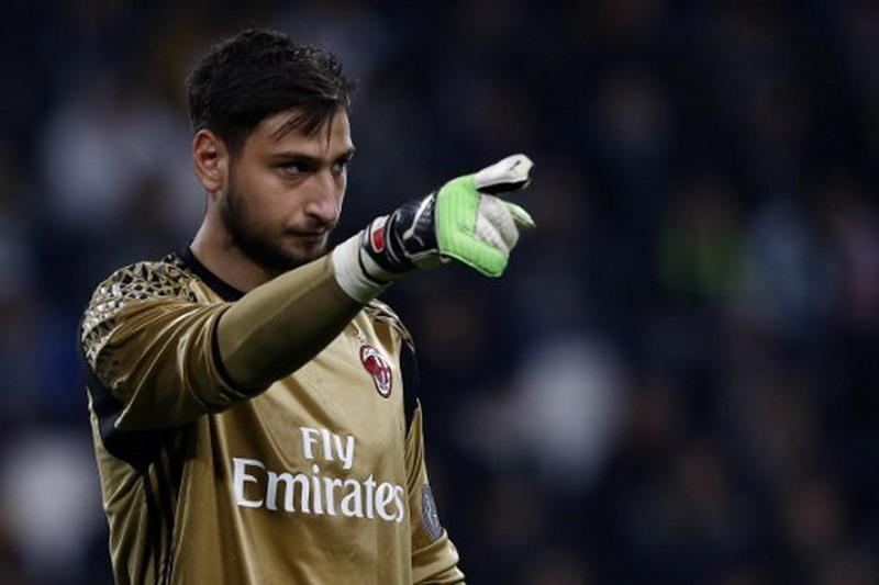 Donnarumma urung jadi kapten Milan. (Foto: AFP/Marco Bertorello)