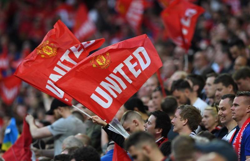 Fans Man United (Foto: Paul Ellis/AFP)