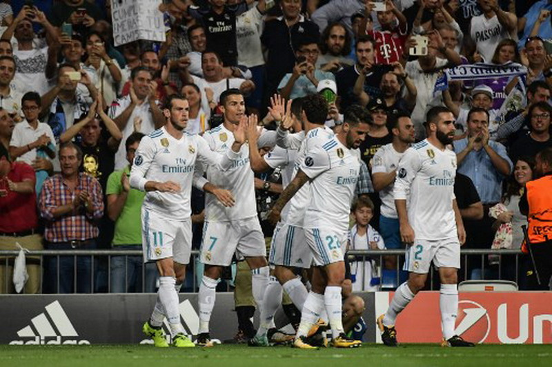 Ronaldo sebut perjalanan Madrid masih panjang. (Foto: AFP/Pierre Phillipe Marcou)