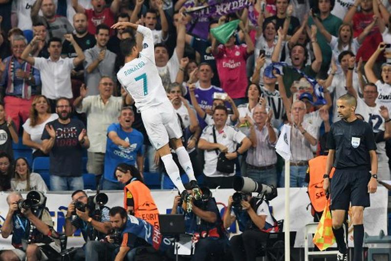Ronaldo merayakan gol ke gawang APOEL. (Foto: AFP/Gabriel Bouys)