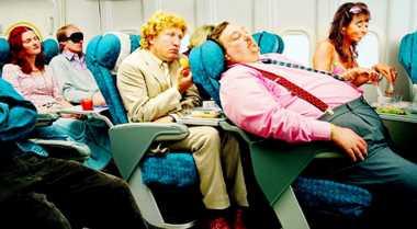 Trik Mengurangi Kram dan Pegal di Pesawat