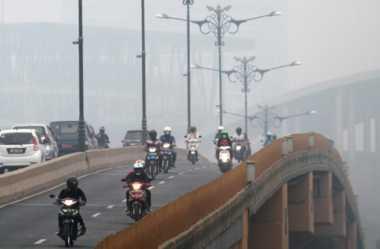 Dampak Kabut Asap, Ribuan Warga Riau Terserang ISPA