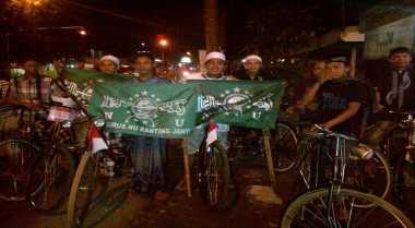 Arif Kayuh Onthel Sejauh 14 Km ke Arena Muktamar NU