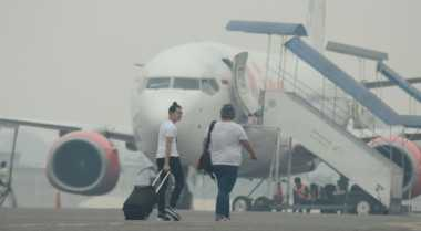 Bandara SSK Lumpuh, 59 Penerbangan Dibatalkan