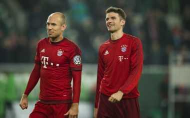 Muller Bahagia di Atas Penderitaan Robben