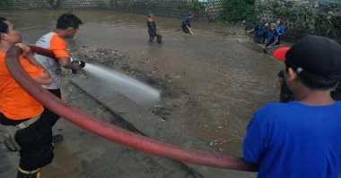 Tangani Banjir Depok, Satgas Perlancar Aliran Kali Jantung