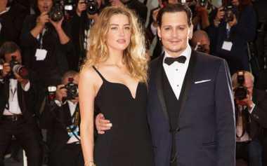KDRT Jadi Alasan Perceraian Amber Heard dan Johnny Depp