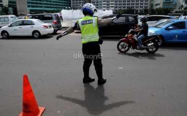 Ekspresi Kesibukan Petugas Kepolisian di Tour de Jakarta