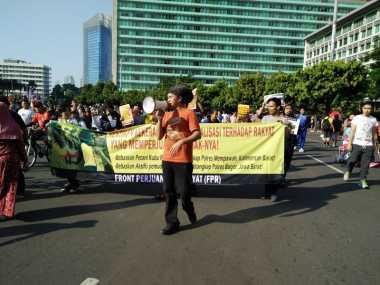 Hentikan Kriminalisasi Petani, Kembalikan Tanah Mereka