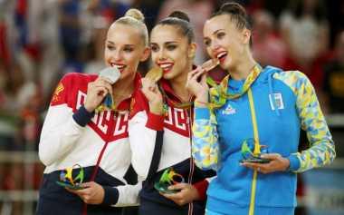 Sportpedia: Asal Mula Atlet Olimpiade Berpose Gigit Medali
