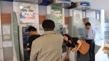 Waspada! Ada Stiker Call Center Palsu di Mesin ATM