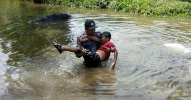 Kisah Anggota Polisi Selamatkan Bocah Nyaris Tenggelam