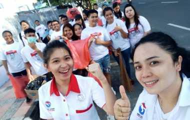 Bersih-Bersih Jalan, Cara DPW Pemuda Perindo Sulut Bersilaturahmi dengan Masyarakat
