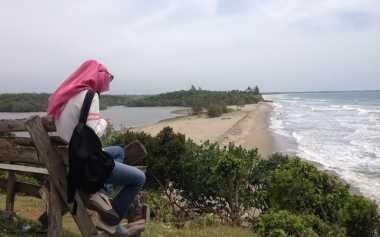 Surga di Bumi Rafflesia: Menyambangi Danau Gedang di Tepi Pantai Padang Betuah