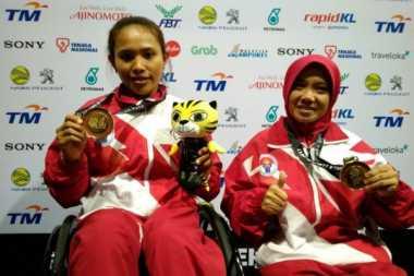 Raih Tujuh Medali Emas, Tim Angkat Berat Indonesia Juara Umum di ASEAN Para Games 2017