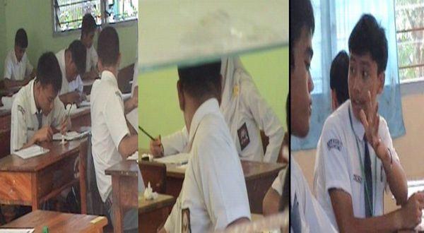 Sejumlah peserta UN mencontek di ruang ujian. (Foto: Bulan Sri Indra/okezone)