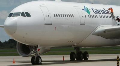 Ilustrasi pesawat Garuda